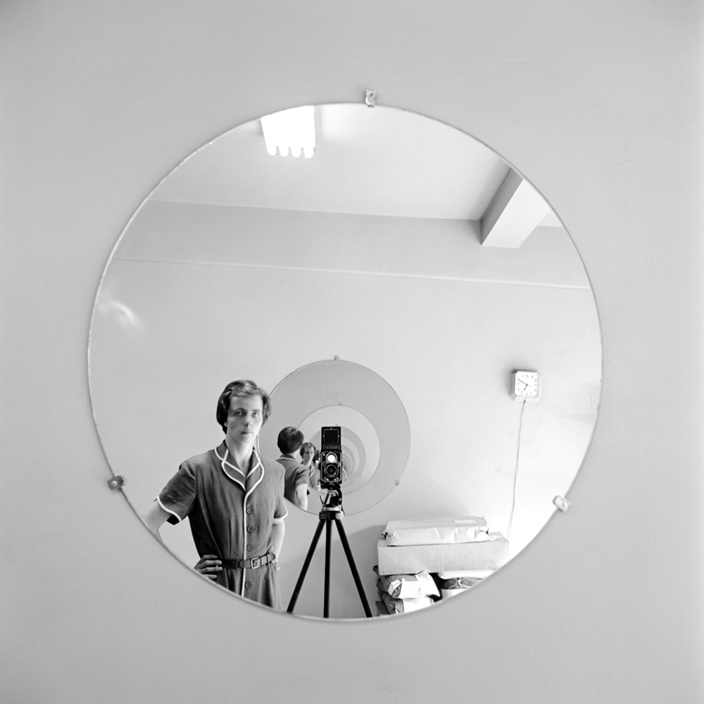 "Nanny or artist? The mysterious subject of the documentary ""Finding Vivian Maier"" turns the mirror on herself. Via Ravine Pictures."