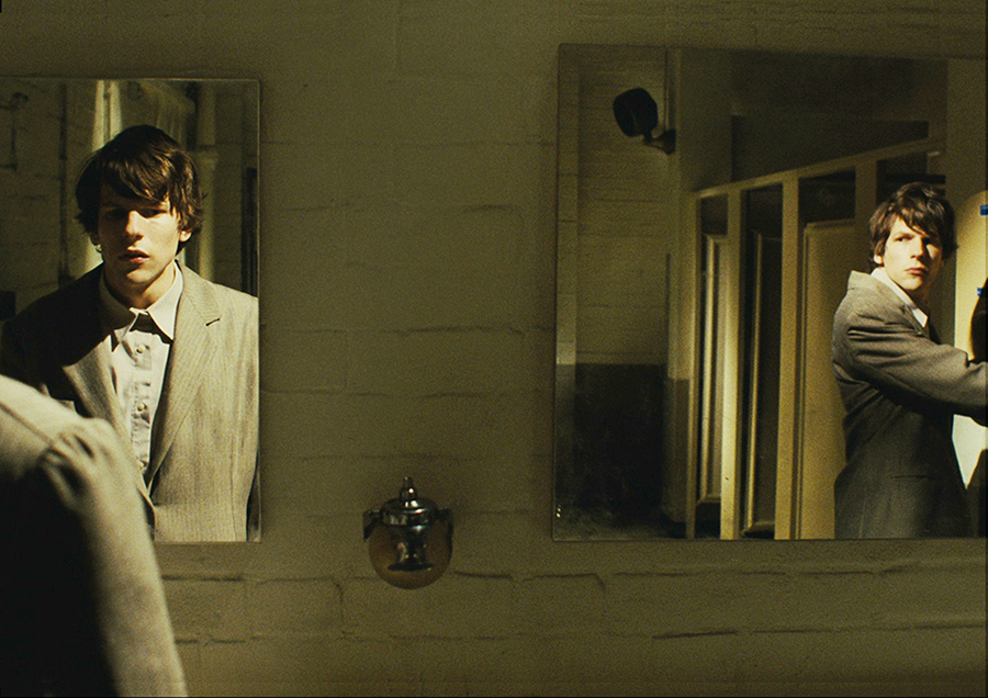 "In a dual role as the meek and mild-mannered Simon and his exact-opposite and wildly confident doppelganger James, actor Jesse Eisenberg stars in the dark comedy ""The Double."" Via Magnolia Pictures."