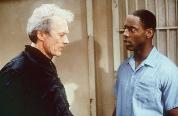 "Ebert's review went beyond the film with Clint Eastwood, left, as an alcoholic journalist, and Isaiah Washington as a wrongly convicted murderer in ""True Crime."" Via Warner Bros."