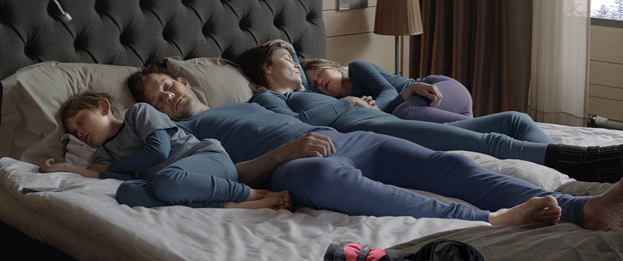 """The warm, muted tones of a family's lives on the inside contrasts with the harsh, bright tones of their lives on the outside in the Swedish drama """"Force Majeure."""" Via Magnolia Pictures."""