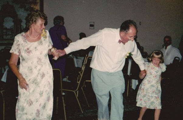 Long after her grandparents' 50th wedding anniversary in 2001, our intern Megan Ginise (age 8 in this photo) is still dancing with her grandfather, if only in memory.