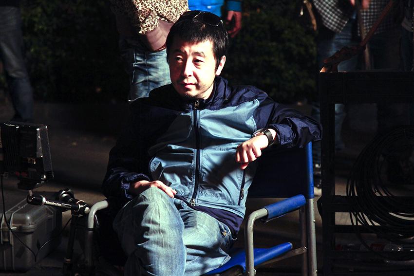 "Chinese director Jia Zhang-ke on the set of ""Mountains May Depart."" Via Kino Lorber."