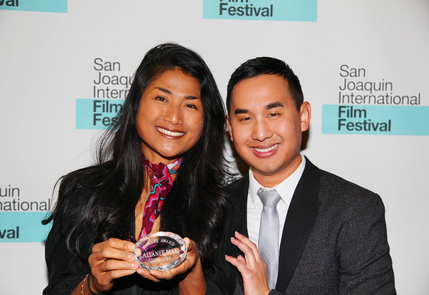 Cambodian-born filmmaker Kalyanee Mam, left, with Cambodian-born film festival programmer Sophoan Sorn, director of the San Joaquin International Film Festival in Stockton, in January 2014. Via SJIFF.